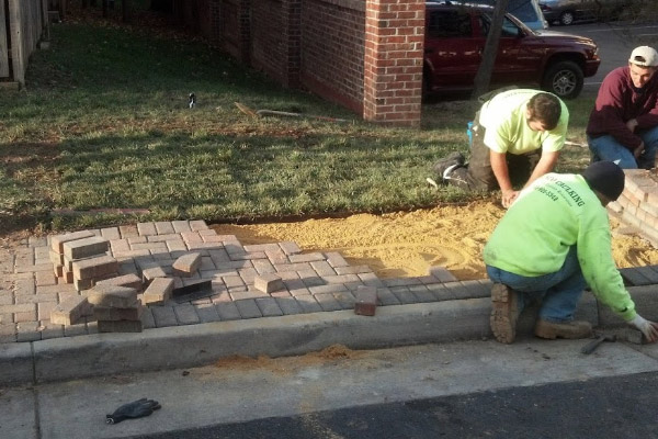 Laying Brick Sidewalk by PSI Employee- Commercial Power Washing Also Available in Washington DC Metro Area